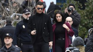 Juventus' forward and former Real Madrid player Cristiano Ronaldo leaves with his Spanish girlfriend Georgina Rodriguez after attending a court hearing for tax evasion in Madrid on January 22, 2019. - Ronaldo is expected to be given a hefty fine after Spanish tax authorities and the player's advisors made a deal to settle claims he hid income generated from image rights when he played for Real Madrid. (Photo by PIERRE-PHILIPPE MARCOU / AFP)