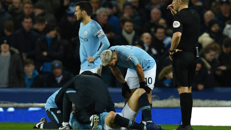 Manchester City's French defender Aymeric Laporte receives medical treatment during the English Premier League football match between Everton and Manchester City at Goodison Park in Liverpool, north west England on February 6, 2019. (Photo by Paul ELLIS / AFP) / RESTRICTED TO EDITORIAL USE. No use with unauthorized audio, video, data, fixture lists, club/league logos or 'live' services. Online in-match use limited to 120 images. An additional 40 images may be used in extra time. No video emulation. Social media in-match use limited to 120 images. An additional 40 images may be used in extra time. No use in betting publications, games or single club/league/player publications. /