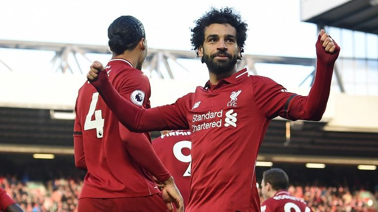Liverpool's Egyptian midfielder Mohamed Salah (C) celebrates after scoring their third goal during the English Premier League football match between Liverpool and Bournemouth at Anfield in Liverpool, north west England on February 9, 2019. (Photo by Paul ELLIS / AFP) / RESTRICTED TO EDITORIAL USE. No use with unauthorized audio, video, data, fixture lists, club/league logos or 'live' services. Online in-match use limited to 120 images. An additional 40 images may be used in extra time. No video emulation. Social media in-match use limited to 120 images. An additional 40 images may be used in extra time. No use in betting publications, games or single club/league/player publications. /
