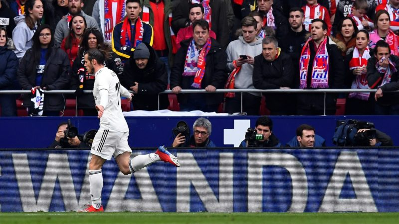 Real Madrid's Welsh forward Gareth Bale celebrates after scoring a goal during the Spanish league football match between Club Atletico de Madrid and Real Madrid CF at the Wanda Metropolitano stadium in Madrid on February 9, 2019. (Photo by GABRIEL BOUYS / AFP)