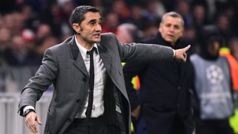 Barcelona's Spanish coach Ernesto Valverde gestures next to Lyon's French coach Bruno Genesio (R) during the UEFA Champions League round of 16 first leg football match between Lyon (OL) and FC Barcelona on February 19, 2019, at the Groupama Stadium in Decines-Charpieu, central-eastern France. (Photo by FRANCK FIFE / AFP)