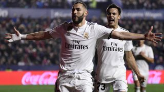 Real Madrid's French forward Karim Benzema celebrates with Real Madrid's Spanish defender Sergio Reguilon (R) after scoring a goal during the Spanish league football match between Levante UD and Real Madrid CF at the Ciutat de Valencia stadium in Valencia on February 24, 2019. (Photo by JOSE JORDAN / AFP)