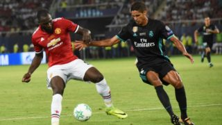 Manchester United's Belgian striker Romelu Lukaku (L) vies with Real Madrid's French defender Raphael Varane during the UEFA Super Cup football match between Real Madrid and Manchester United on August 8, 2017, at the Philip II Arena in Skopje. (Photo by ARMEND NIMANI / AFP)