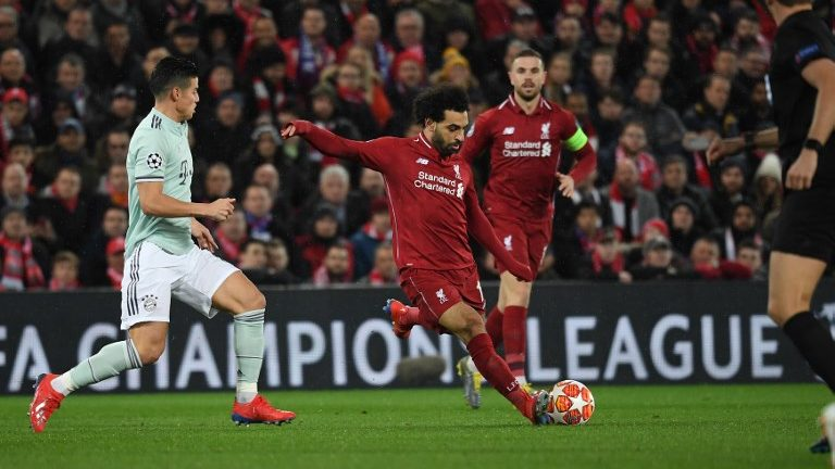 19 February 2019, Great Britain, Liverpool: Soccer: Champions League, FC Liverpool - Bayern Munich, knockout round, round of sixteen, first leg in Anfield Stadium. James Rodriguez (l) from Munich and Mohamed Salah (M) from Liverpool fight for the ball. Photo: Sven Hoppe/dpa