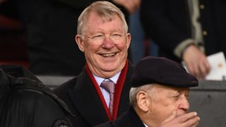 Former Manchester United manager Alex Ferguson reacts ahead of the first leg of the UEFA Champions League round of 16 football match between Manchester United and Paris Saint-Germain (PSG) at Old Trafford in Manchester, north-west England on February 12, 2019. (Photo by FRANCK FIFE / AFP)