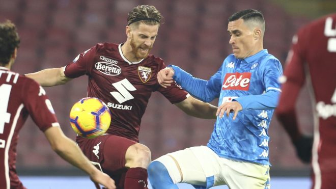Napoli's Spanish striker Jose Maria Callejon (R) fights for the ball with Torino's defender from Argentina Cristian Ansaldi during the Italian Serie A football match SSC Napoli vs Torino FC on Febuary 17 2019 at the San Paolo Stadium. (Photo by CARLO HERMANN / AFP)