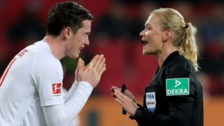 AUGSBURG, GERMANY - FEBRUARY 15: Referee Bibiana Steinhaus reacts to Michael Gregoritsch of Augsburg during the Bundesliga match between FC Augsburg and FC Bayern Muenchen at WWK-Arena on February 15, 2019 in Augsburg, Germany. (Photo by Alexander Hassenstein/Bongarts/Getty Images)