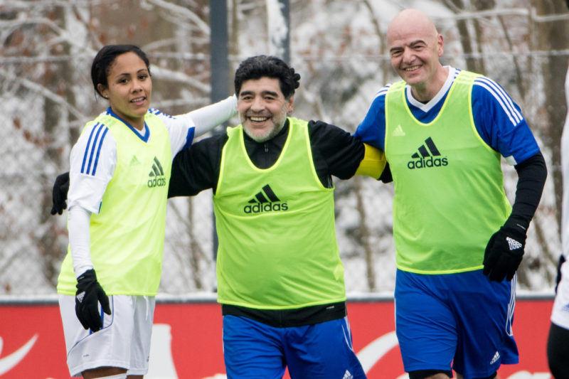 ZURICH, SWITZERLAND - JANUARY 09: (L-R) Alex Scott, Diego Maradona and FIFA president Gianni Infantino celebrate a goal during a FIFA Team Friendly Football Match at the FIFA headquarters prior to The Best FIFA Football Awards 2016 on January 9, 2017 in Zurich, Switzerland. (Photo by Philipp Schmidli/Getty Images)