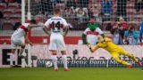 Stuttgart's Swiss midfielder Steven Zuber (L) scores from the penalty spot past Leipzig's Hungarian goalkeeper Peter Gulacsi during the German first division Bundesliga football match VfB Stuttgart vs RB Leipzig on February 16, 2019 in Stuttgart. (Photo by Sebastian Gollnow / dpa / AFP) / Germany OUT / DFL REGULATIONS PROHIBIT ANY USE OF PHOTOGRAPHS AS IMAGE SEQUENCES AND/OR QUASI-VIDEO