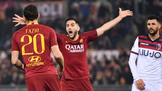 AS Roma's Argentine defender Federico Fazio (L) celebrates with AS Roma's Greek defender Kostas Manolas (C) after scoring during the Italian Serie A football match between Roma and Bologna at the Olympic stadium, in Rome, on February 18, 2019. (Photo by Alberto PIZZOLI / AFP)