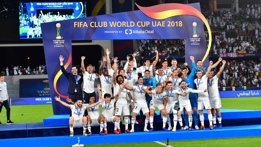 Real Madrid's players celebrate with the trophy after winning the FIFA Club World Cup final football match Spain's Real Madrid vs Abu Dhabi's Al Ain at the Zayed Sports City Stadium in Abu Dhabi, the capital of the United Arab Emirates, on December 22, 2018. (Photo by Giuseppe CACACE / AFP)