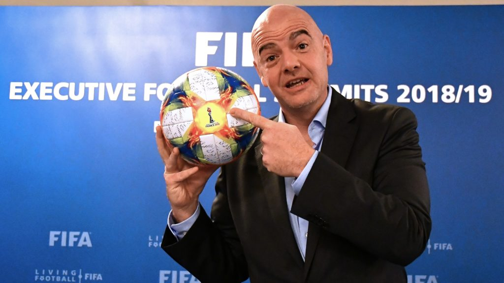 FIFA President Gianni Infantino poses with the official ball of the 2019 Women's World Cup during a press conference at the end of the FIFA Executive Football Summit in Rome on February 27, 2019. (Photo by Alberto PIZZOLI / AFP)