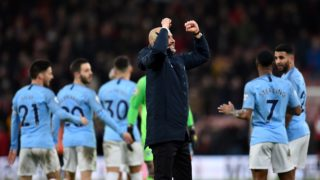 Manchester City's Spanish manager Pep Guardiola (C) applauds the fans following during the English Premier League football match between Bournemouth and Manchester City at the Vitality Stadium in Bournemouth, southern England on March 2, 2019. - Manchester City won the match 1-0. (Photo by Glyn KIRK / AFP) / RESTRICTED TO EDITORIAL USE. No use with unauthorized audio, video, data, fixture lists, club/league logos or 'live' services. Online in-match use limited to 120 images. An additional 40 images may be used in extra time. No video emulation. Social media in-match use limited to 120 images. An additional 40 images may be used in extra time. No use in betting publications, games or single club/league/player publications. /