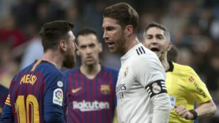 Barcelona's Argentinian forward Lionel Messi (L) argues with Real Madrid's Spanish defender Sergio Ramos during the Spanish league football match between Real Madrid CF and FC Barcelona at the Santiago Bernabeu stadium in Madrid on March 2, 2019. (Photo by CURTO DE LA TORRE / AFP)