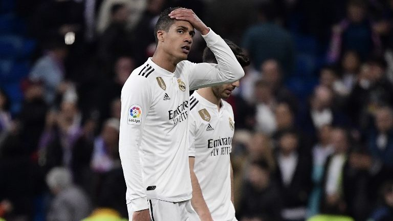 Real Madrid's French defender Raphael Varane reacts at the end of the Spanish league football match between Real Madrid CF and FC Barcelona at the Santiago Bernabeu stadium in Madrid on March 2, 2019. (Photo by JAVIER SORIANO / AFP)