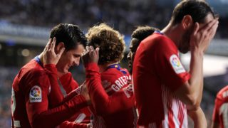 Atletico Madrid's Spanish forward Alvaro Morata (L) celebrates with teammates after scoring a goal during the Spanish league football match between Real Sociedad and Club Atletico de Madrid at the Anoeta stadium in San Sebastian on March 3, 2019. (Photo by ANDER GILLENEA / AFP)