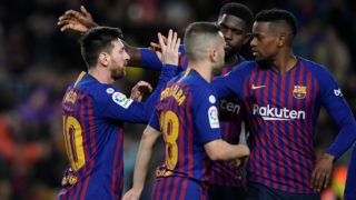 Barcelona's Argentinian forward Lionel Messi (L) celebrates with Barcelona's Spanish defender Jordi Alba, Barcelona's French defender Samuel Umtiti and Barcelona's Portuguese defender Nelson Semedo after scoring during the Spanish league football match between FC Barcelona and Rayo Vallecano de Madrid at the Camp Nou stadium in Barcelona on March 9, 2019. (Photo by LLUIS GENE / AFP)