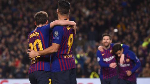 Barcelona's Uruguayan forward Luis Suarez (C) and Barcelona's Spanish midfielder Sergi Roberto celebrate after Barcelona's Brazilian midfielder Philippe Coutinho scored a goal during the UEFA Champions League round of 16, second leg football match between FC Barcelona and Olympique Lyonnais at the Camp Nou stadium in Barcelona on March 13, 2019. (Photo by Josep LAGO / AFP)