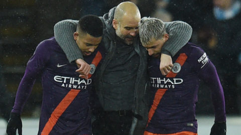 Manchester City's Spanish coach Josep Guardiola (C) congratulates Manchester City's Brazilian forward Gabriel Jesus (L) and Manchester City's Argentine forward Sergio Aguero after winning the FA Cup quarter-final football match between Swansea City and Manchester City at The Liberty Stadium in Swansea, south Wales on March 16, 2019. (Photo by Oli SCARFF / AFP) / RESTRICTED TO EDITORIAL USE. No use with unauthorized audio, video, data, fixture lists, club/league logos or 'live' services. Online in-match use limited to 120 images. An additional 40 images may be used in extra time. No video emulation. Social media in-match use limited to 120 images. An additional 40 images may be used in extra time. No use in betting publications, games or single club/league/player publications. /