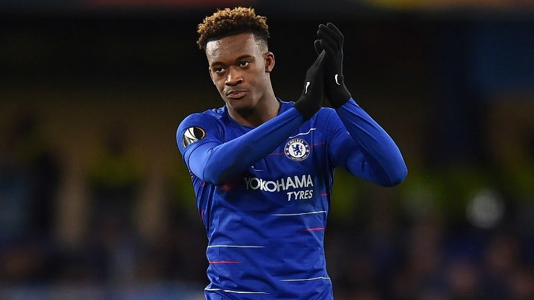 (FILES) In this file photo taken on March 7, 2019 Chelsea's English midfielder Callum Hudson-Odoi applauds supporters on the pitch after the first leg of the UEFA Europa League round of 16 football match between Chelsea and Dynamo Kiev at Stamford Bridge stadium in London. - Chelsea teenager Callum Hudson-Odoi was called up by England for the first time on Monday, March 18, 2019 amid a series of withdrawals due to injury. (Photo by Glyn KIRK / AFP)