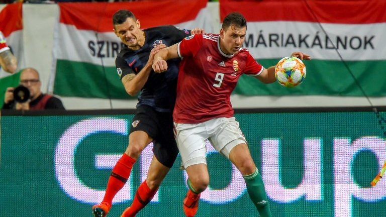 Croatia's defender Dejan Lovren (L) fights for the ball with with Hungary's Adam Szalai during the UEFA Euro 2020 football 1st round Groupe E qualification match between Hungary and Croatia on March 24, 2019 in Budapest. (Photo by ATTILA KISBENEDEK / AFP)