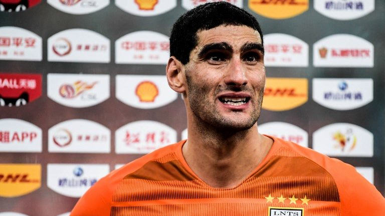 Belgian football player Marouane Fellaini receives an interview after the first round match against Beijing Renhe F.C during the 2019 Chinese Football Association Super League in Ji'nan city, east China's Shandong province, 1 March 2019.  Former Everton and Manchester United midfielder Marouane Fellaini has announced his international retirement at the age of 31.