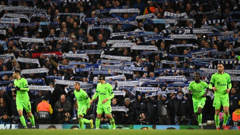12 March 2019, Great Britain, Manchester: Soccer: Champions League, knockout round, round of sixteen, second leg: Manchester City - FC Schalke 04 in Ethiad Stadium. The Schalkes fans who travelled with them show their scarves in the stands. Photo: Ina Fassbender/dpa