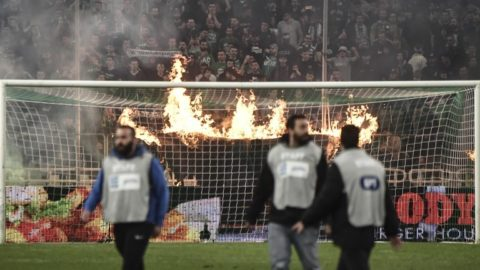 Panathinaikos fans burn a cloth banner during Greek Super League football match between Panathinaikos Athens and Olympiakos Piraeus at Olympic Stadium in Athens, Greece on March 17, 2019. (Photo by Dimitris Lampropoulos/NurPhoto)
