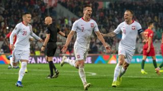 Arkadiusz Milik (7) of Poland celebrates scoring with Piotr Zielinski and Kamil Grosicki during the UEFA Nations League A Group 3 match between Portugal and Poland at Estadio D. Afonso Henriques in Guimaraes, Portugal on November 20, 2018  (Photo by Andrew Surma/NurPhoto)