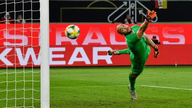 Serbia's goalkeeper Marko Dmitrovic fails to stop Germany's midfielder Leon Goretzka's shot during the friendly football match Germany v Serbia in Wolfsburg, western Germany on March 20, 2019. (Photo by John MACDOUGALL / AFP) / RESTRICTIONS: ACCORDING TO DFB RULES IMAGE SEQUENCES TO SIMULATE VIDEO IS NOT ALLOWED DURING MATCH TIME. MOBILE (MMS) USE IS NOT ALLOWED DURING AND FOR FURTHER TWO HOURS AFTER THE MATCH. == RESTRICTED TO EDITORIAL USE == FOR MORE INFORMATION CONTACT DFB DIRECTLY AT +49 69 67880 /