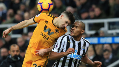 Wolverhampton Wanderers' Portuguese defender Ruben Vinagre (L) vies with Newcastle United's Venezuelan striker Salomon Rondon (R) during the English Premier League football match between Newcastle United and Wolverhampton Wanderers at St James' Park in Newcastle-upon-Tyne, north east England on December 9, 2018. (Photo by Lindsey PARNABY / AFP) / RESTRICTED TO EDITORIAL USE. No use with unauthorized audio, video, data, fixture lists, club/league logos or 'live' services. Online in-match use limited to 120 images. An additional 40 images may be used in extra time. No video emulation. Social media in-match use limited to 120 images. An additional 40 images may be used in extra time. No use in betting publications, games or single club/league/player publications. /