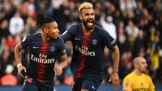 Paris Saint-Germain's French midfielder Christopher Nkunku celebrates scoring his team's first goal with Paris Saint-Germain's Cameroonian forward Eric Choupo-Moting (R) during the French L1 football match between Paris Saint-Germain and Nimes at the Parc de Princes in Paris on 23 February 2019. (Photo by FRANCK FIFE / AFP)