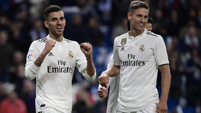Real Madrid's Spanish midfielder Daniel Ceballos (L) celebrates with Real Madrid's Spanish miedfieder Marcos Llorente after scoring a goal during the Spanish League football match between Real Madrid CF and SD Huesca at the Santiago Bernabeu stadium in Madrid on March 31, 2019. (Photo by JAVIER SORIANO / AFP)