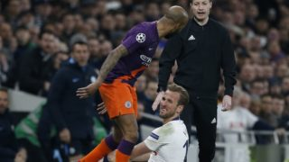 Manchester City's English midfielder Fabian Delph (L) remostrates with Tottenham Hotspur's English striker Harry Kane before Kane left the pitch injured during the UEFA Champions League quarter-final first leg football match between Tottenham Hotspur and Manchester City at the Tottenham Hotspur Stadium in north London, on April 9, 2019. (Photo by Ian KINGTON / IKIMAGES / AFP)