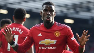 Manchester United's French midfielder Paul Pogba celebrates after he scores the team's first goal during the English Premier League football match between Manchester United and West Ham United at Old Trafford in Manchester, north west England, on April 13, 2019. (Photo by Paul ELLIS / AFP) / RESTRICTED TO EDITORIAL USE. No use with unauthorized audio, video, data, fixture lists, club/league logos or 'live' services. Online in-match use limited to 120 images. An additional 40 images may be used in extra time. No video emulation. Social media in-match use limited to 120 images. An additional 40 images may be used in extra time. No use in betting publications, games or single club/league/player publications. /