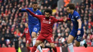 Liverpool's Egyptian midfielder Mohamed Salah (C) vies with Chelsea's English midfielder Ruben Loftus-Cheek (L) and Chelsea's Brazilian defender David Luiz (R) during the English Premier League football match between Liverpool and Chelsea at Anfield in Liverpool, north west England on April 14, 2019. (Photo by Paul ELLIS / AFP) / RESTRICTED TO EDITORIAL USE. No use with unauthorized audio, video, data, fixture lists, club/league logos or 'live' services. Online in-match use limited to 120 images. An additional 40 images may be used in extra time. No video emulation. Social media in-match use limited to 120 images. An additional 40 images may be used in extra time. No use in betting publications, games or single club/league/player publications. /