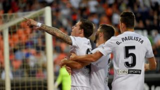 Valencia's Spanish forward Santi Mina (L) celebrates with Valencia's Spanish defender Jose Gaya and Valencia's Brazilian defender Gabriel after scoring during the Spanish league football match between Valencia CF and Levante UD at the Mestalla stadium in Valencia on April 14, 2019. (Photo by JOSE JORDAN / AFP)