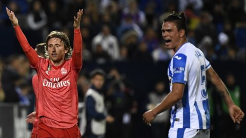 Real Madrid's Croatian midfielder Luka Modric (L) and Leganes' Argentinian defender Jonathan Silva react during the Spanish league football match between Club Deportivo Leganes SAD and Real Madrid CF at the Estadio Municipal Butarque in Leganes on April 15, 2019. (Photo by PIERRE-PHILIPPE MARCOU / AFP)