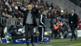 Bayern Munich's Spanish head coach Pep Guardiola (L) celebrates his team's victory next to Juventus' coach from Italy Massimiliano Allegri (R) after the extra time of the UEFA Champions League, Round of 16, second leg football match FC Bayern Munich v Juventus in Munich, southern Germany on March 16, 2016. - Bayern Munich won 4-2 and qualified for the quarter finals. (Photo by TOBIAS SCHWARZ / AFP)
