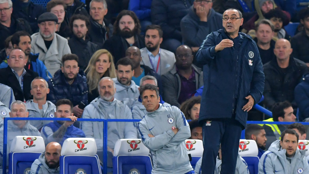 Chelsea's Italian head coach Maurizio Sarri (centre right) and Chelsea's Italian assistant first team coach Gianfranco Zola (C) watch from the touchline during the English Premier League football match between Chelsea and West Ham United at Stamford Bridge in London on April 8, 2019. (Photo by OLLY GREENWOOD / AFP) / RESTRICTED TO EDITORIAL USE. No use with unauthorized audio, video, data, fixture lists, club/league logos or 'live' services. Online in-match use limited to 120 images. An additional 40 images may be used in extra time. No video emulation. Social media in-match use limited to 120 images. An additional 40 images may be used in extra time. No use in betting publications, games or single club/league/player publications. /