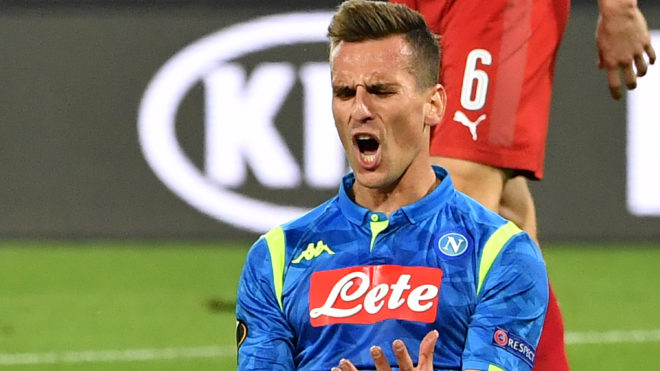 Napoli's Polish forward Arkadiusz Milik reacts after missing a goal opportunity during the UEFA Europa League quarter-final second leg football match Napoli vs Arsenal on April 18, 2019 at the San Paolo stadium in Naples. (Photo by Andreas SOLARO / AFP)