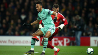 WATFORD, ENGLAND - APRIL 15:  Pierre-Emerick Aubameyang of Arsenal scores his side's first goal past Ben Foster of Watford during the Premier League match between Watford FC and Arsenal FC at Vicarage Road on April 15, 2019 in Watford, United Kingdom. (Photo by Marc Atkins/Getty Images)