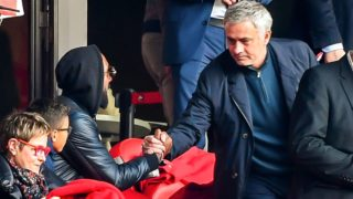 Former Manchester United manager Jose Mourinho (R) shake hands with French football manager and former player Nicolas Anelka at the start of the French L1 football match Lille vs Montpellier on Februrary 17, 2019 at the Pierre Mauroy Stadium in Villeneuve-d'Ascq, northern France. (Photo by PHILIPPE HUGUEN / AFP)