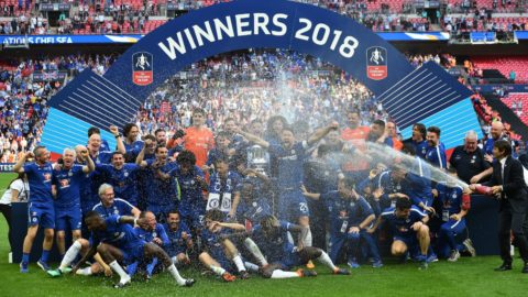 Chelsea's Italian head coach Antonio Conte (R) sprays champagne as his Chelsea players celebrate with the trophy after their victory in the English FA Cup final football match between Chelsea and Manchester United at Wembley stadium in London on May 19, 2018. - Chelsea won the game 1-0. (Photo by Glyn KIRK / AFP) / NOT FOR MARKETING OR ADVERTISING USE / RESTRICTED TO EDITORIAL USE
