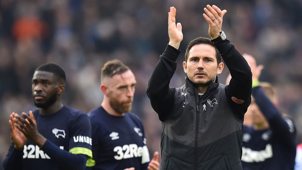 Derby County's English manager Frank Lampard applauds the fans following the English FA Cup fifth round football match between Brighton and Hove Albion and Derby County at the American Express Community Stadium in Brighton, southern England on February 16, 2019. - Brighton won the match 2-1. (Photo by Glyn KIRK / AFP) / RESTRICTED TO EDITORIAL USE. No use with unauthorized audio, video, data, fixture lists, club/league logos or 'live' services. Online in-match use limited to 120 images. An additional 40 images may be used in extra time. No video emulation. Social media in-match use limited to 120 images. An additional 40 images may be used in extra time. No use in betting publications, games or single club/league/player publications. /