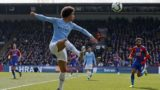 Manchester City's German midfielder Leroy Sane controls the ball during the English Premier League football match between Crystal Palace and Manchester City at Selhurst Park in south London on April 14, 2019. (Photo by Adrian DENNIS / AFP) / RESTRICTED TO EDITORIAL USE. No use with unauthorized audio, video, data, fixture lists, club/league logos or 'live' services. Online in-match use limited to 120 images. An additional 40 images may be used in extra time. No video emulation. Social media in-match use limited to 120 images. An additional 40 images may be used in extra time. No use in betting publications, games or single club/league/player publications. /