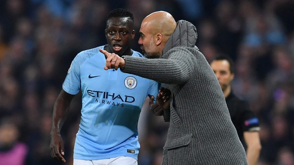 Manchester City's Spanish manager Pep Guardiola gestures to Manchester City's French defender Benjamin Mendy during the UEFA Champions League quarter final second leg football match between Manchester City and Tottenham Hotspur at the Etihad Stadium in Manchester, north west England on April 17, 2019. (Photo by Ben STANSALL / AFP)