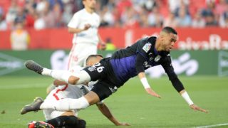 Leganes' Moroccan forward Youssef En-Nesyri (R) falls down during the Spanish league football match between Sevilla FC and Club Deportivo Leganes SAD at the Ramon Sanchez Pizjuan stadium in Seville on May 3, 2019. (Photo by CRISTINA QUICLER / AFP)