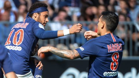 Paris Saint-Germain's Brazilian forward Neymar (L) celebrates with Paris Saint-Germain's Argentine midfielder Leandro Paredes after scoring his team first goal during the French L1 football match between Angers (SCO) and Paris Saint-Germain (PSG), on May 11, 2019, at the Raymond-Kopa Stadium, in Angers. (Photo by JEAN-FRANCOIS MONIER / AFP)