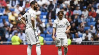 Real Madrid's French forward Karim Benzema and Real Madrid's Croatian midfielder Luka Modric (back) react after Real Betis scored a goal during the Spanish League football match between Real Madrid and Real Betis at the Santiago Bernabeu stadium in Madrid on May 19, 2019. (Photo by PIERRE-PHILIPPE MARCOU / AFP)